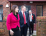 © Joel Goodman - 07973 332324 .  04/02/2014 . Sale , UK . L-R Rachel Reeves , Chris Bryant and Mike Kane leave Tony Gunning's flat . Rachel Reeves , MP for Leeds West and Shadow Secretary of State for Work and Pensions and Chris Bryant , MP for Rhondda and Shadow Minister for Welfare Reform , join Labour candidate Mike Kane on the campaign trail ahead of the Wythenshawe and Sale East by-election , following the death of MP Paul Goggins . They visit the home of Tony Gunning (51) who suffers from hereditary adult polycystic kidney disease and is on dialysis , who says he is affected by the bedroom tax . Photo credit : Joel Goodman