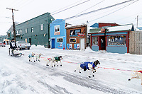 Gunnar Johnson runs down Front Street on the way to the finish line in Nome  during the 2017 Iditarod on Friday March 17, 2017.<br /> <br /> Photo by Jeff Schultz/SchultzPhoto.com  (C) 2017  ALL RIGHTS RESERVED