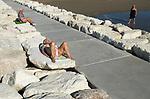 Italian seniors sun bathing at the Venice Lido. Italy 2009.
