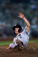 Dayton Dragons Matt McLain (23) slides home safely during a game against the Fort Wayne TinCaps on August 27, 2021 at Parkview Field in Fort Wayne, Indiana.  (Mike Janes/Four Seam Images)