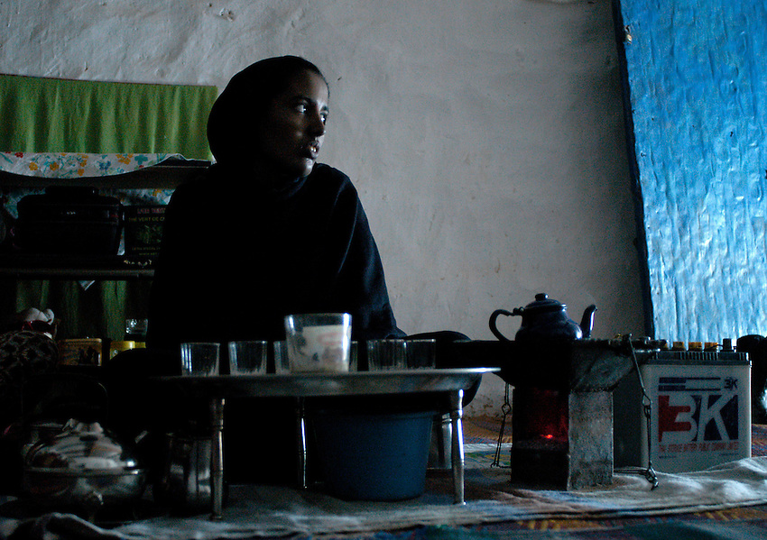 A women prepares a tea on December 15, 2033. Saharawi people have been living at the refugee camps of the Algerian desert named Hamada, or desert of the deserts, for more than 30 years now. Saharawi people have suffered the consecuences of European colonialism and the war against occupation by Moroccan forces. Polisario and Moroccan Army are in conflict since 1975 when Hassan II, Moroccan King in 1975, sent more than 250.000 civilians and soldiers to colonize the Western Sahara when Spain left the country. Since 1991 they are in a peace process without any outcome so far. (Ander Gillenea / Bostok Photo)