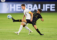 CARSON, CA - SEPTEMBER 06: Diego Rossi #9 of LAFC beats Daniel Steres #5 of the Los Angeles Galaxy to the ball during a game between Los Angeles FC and Los Angeles Galaxy at Dignity Health Sports Park on September 06, 2020 in Carson, California.