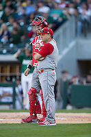 North Carolina State Wolfpack head coach Elliott Avent (9) and catcher Andrew Knizner (11) wait for the umpires t discuss a call during the game against the Charlotte 49ers at BB&T Ballpark on March 31, 2015 in Charlotte, North Carolina.  The Wolfpack defeated the 49ers 10-6.  (Brian Westerholt/Four Seam Images)