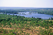 Zambesi River, Zambia. High view of river in full flood with scrubland in the foreground.