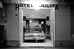 Car parked inside hotel for safe keeping at night. Mexico 1970s.