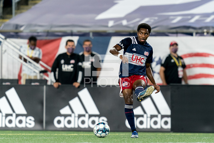 FOXBOROUGH, MA - SEPTEMBER 09: Jon Bell #70 of New England Revolution II passes the ball during a game between Chattanooga Red Wolves SC and New England Revolution II at Gillette Stadium on September 09, 2020 in Foxborough, Massachusetts.
