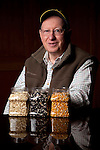 Clarkson Grain founder and president Lynn Clarkson, shown with non-genetically modified seeds processed at the company's plant near Cerro Gordo, Ill., where they prepare non-GMO corn for food processors. Food companies' move toward non-genetically modified ingredients has increased demand for the limited supply of non-GMO crops.<br /> Kristen Schmid for the New York Times