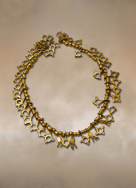 Bronze Age Hattian gold necklace from Grave TM, possibly a Bronze Age Royal grave (2500 BC to 2250 BC) - Alacahoyuk - Museum of Anatolian Civilisations, Ankara, Turkey. Against a warm art background