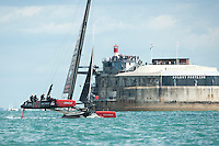 25 July 2015: Oracle Team USA passes in front of the Spit Fort in the Solent during the America's Cup first round racing off Portsmouth, England (Photo by Rob Munro)