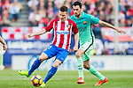 Kevin Gameiro (l) of Atletico de Madrid competes for the ball with Sergio Busquets Burgos of FC Barcelona in action during their La Liga match between Atletico de Madrid and FC Barcelona at the Santiago Bernabeu Stadium on 26 February 2017 in Madrid, Spain. Photo by Diego Gonzalez Souto / Power Sport Images