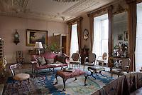 Floor-to-ceiling sash windows flood light into the drawing room