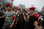 """Remi OCHLIK/IP3 -  February 5 2011  CAIRO General Hassan El Noori head of the Egyptian army visits people in Tahrir square and deliver a speech to encourage people go home..The top leadership body of Egypt's ruling party resigned Saturday, including the president's son, but the regime appeared to be digging in its heels, calculating that it can ride out street demonstrations and keep President Hosni Mubarak in office. Protesters have refused to end their mass rallies in downtown Tahrir Square until Mubarak quits. Tens of thousands gathered Saturday in Tahrir, waving flags and chanting a day after some 100,000 massed there in an intensified demonstration labeled """"the day of departure,"""" in hopes it would be the day Mubarak leaves...Their unprecedented 12-day movement has entered a delicate new phase. Organizers fear that without the pressure of protesters on the street, Mubarak's regime will enact only cosmetic reforms and try to preserve its grip on power. So they are reluctant to lift their demonstrations without the concrete gain of Mubarak's ouster and a transition mechanism that guarantees a real move to democracy afterward"""