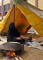"""Palestinian women cook traditional food during celebrations marking the 60th anniversary of the 'Nakba' (catastrophe) on May 15, 2008 in Gaza City. As Israel celebrates its 60th anniversary, Palestinians commemorate the Nakba, the expulsion of some 700,000 people during the 1948 war, an event that for them is the core of the decades-old Middle East conflict.""""photo by Fady Adwan"""""""