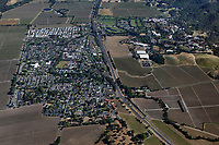 aerial photograph of Yountville, Napa County, California;  Highway 29 separates the town of Yountville, left from the Vinter's Golf Club and Veteran's Administration hospital and facilities, background right