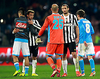 Calcio, Serie A: Napoli vs Juventus. Napoli, stadio San Paolo, 30 marzo 2014. <br /> Napoli goalkeeper Jose' Manuel Reina, of Spain, center, greets Juventus defender Giorgio Chiellini past Napoli midfielder Jorginho, of Brazil, right, as Napoli midfielder Marek Hamsik, of Slovakia, left, greets Juventus midfielder Claudio Marchisio, at the end of the Italian Serie A football match between Napoli and Juventus at Naples' San Paolo stadium, 30 March 2014. Napoli won 2-0.<br /> UPDATE IMAGES PRESS/Isabella Bonotto