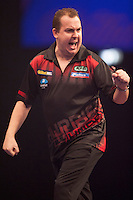 21.12.2014.  London, England.  William Hill World Darts Championship.  Kim Huybrechts (18) [BEL] celebrates a winning leg in his match with Mickey Mansell [NIR]. Huybrechts won the match 3-0