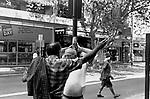 Street scene two men in conversation Kings Cross area. Sydney Australia.