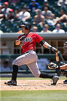 Tony Sanchez (26) of the Indianapolis Indians follows through on his swing against the Charlotte Knights at BB&T BallPark on June 21, 2015 in Charlotte, North Carolina.  The Knights defeated the Indians 13-1.  (Brian Westerholt/Four Seam Images)