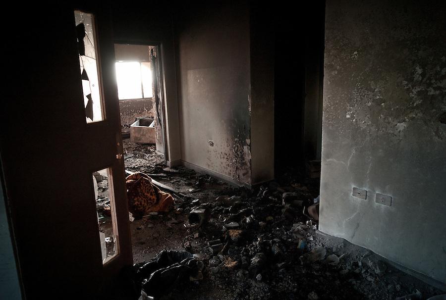 Burnt out checkpoint at Ras Lanuf, LIbya.