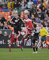 Chicago Fire forward Brian Mcbride (20) heads the ball against DC United defender Marc Burch (4) b, Chicago Fire tied  DC United 1-1 at  RFK Stadium, Saturday March 28, 2009..