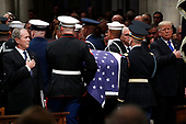 Former President George W. Bush, left, and President Donald Trump stand as the flag-draped casket of former President George H.W. Bush is carried by a military honor guard past President Donald Trump, at the conclusion of a State Funeral at the National Cathedral, Wednesday, Dec. 5, 2018, in Washington.<br /> Credit: Alex Brandon / Pool via CNP
