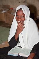 Zanzibar, Tanzania.  Young Girl in Madrassa (Koranic School).