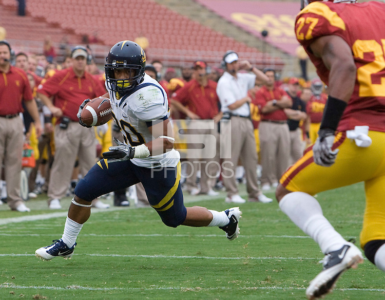Isi Sofele of California rushes the ball during the game against USC at LA Memorial Coliseum in Los Angeles, California.  USC defeated California, 48-14.