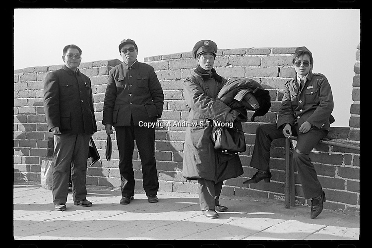 Chinese men dressed in Mao suits and security uniform visit the Great Wall near Beijing, China, 1985.