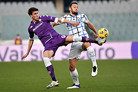 Dusan Vlahovic of ACF Fiorentina and Stefan de Vrij of FC Internazionale compete for the ball during the Italy Cup round of 16 football match between ACF Fiorentina and FC Internazionale at Artemio Franchi stadium in Firenze (Italy), January 13th, 2021. Photo Andrea Staccioli / Insidefoto