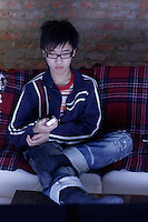 2006 Model Release Photo -<br /> 14 year old chinese teenager watching television