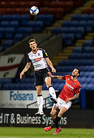 Bolton Wanderers' Ryan Delaney clears under pressure from Salford City's George Boyd (right) <br /> <br /> Photographer Andrew Kearns/CameraSport<br /> <br /> The EFL Sky Bet League Two - Bolton Wanderers v Salford City - Friday 13th November 2020 - University of Bolton Stadium - Bolton<br /> <br /> World Copyright © 2020 CameraSport. All rights reserved. 43 Linden Ave. Countesthorpe. Leicester. England. LE8 5PG - Tel: +44 (0) 116 277 4147 - admin@camerasport.com - www.camerasport.com