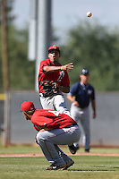Los Angeles Angels of Anaheim second baseman Juan Moreno (6) throws to first over pitcher Tyler Carpenter (44) during an Instructional League game against the Milwaukee Brewers on October 9, 2014 at Tempe Diablo Stadium Complex in Tempe, Arizona.  (Mike Janes/Four Seam Images)
