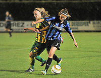 20130906 - VARSENARE , BELGIUM : Brugge's Nicky Van den Abbeele (right) pictured in duel with ADO's Tessa Oudejans (left) during the female soccer match between Club Brugge Vrouwen and ADO DEN HAAG Dames , of the third matchday in the BENELEAGUE competition. Friday 06 th September 2013. PHOTO JOKE VUYLSTEKE