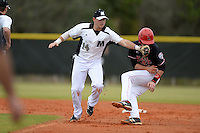 Wisconsin-Milwaukee Panthers shortstop Ryan McShane (14) tags out Alex Maloney (6) during a game against the Ball State Cardinals on February 21, 2014 at North Charlotte Regional Park in Port Charlotte, Florida.  Ball State defeated Wisconsin-Milwaukee 3-1.  (Mike Janes/Four Seam Images)