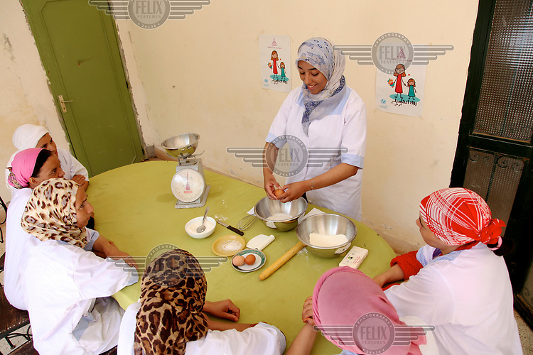 A cooking lesson at a WIDAD centre which offers a shelter and care for 'unmarried' women. The residents are often rape survivors or come from abusive relationships.