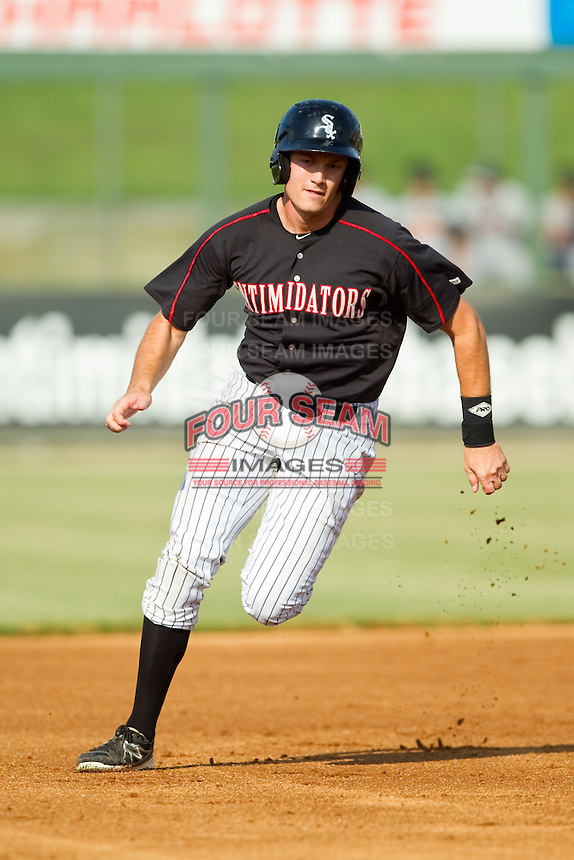 Jason Coats (17) of the Kannapolis Intimidators hustles towards third base against the Rome Braves at CMC-Northeast Stadium on August 25, 2013 in Kannapolis, North Carolina.  The Intimidators defeated the Braves 9-0.  (Brian Westerholt/Four Seam Images)