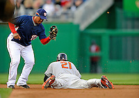 29 March 2008: Washington Nationals' infielder Ronnie Belliard attempts to tag a diving Nick Markakis during an exhibition game against the Baltimore Orioles at Nationals Park, in Washington, DC. The matchup was the first professional baseball game played in the new Nationals Park, prior to the upcoming official opening day inaugural game. The Nationals defeated the Orioles 3-0...Mandatory Photo Credit: Ed Wolfstein Photo