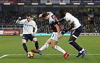 Burnley's James Tarkowski vies for possession with Everton's Bernard (left) and Kurt Zouma<br /> <br /> Photographer Rich Linley/CameraSport<br /> <br /> The Premier League - Burnley v Everton - Wednesday 26th December 2018 - Turf Moor - Burnley<br /> <br /> World Copyright © 2018 CameraSport. All rights reserved. 43 Linden Ave. Countesthorpe. Leicester. England. LE8 5PG - Tel: +44 (0) 116 277 4147 - admin@camerasport.com - www.camerasport.com