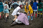 © Joel Goodman - 07973 332324 . 11/06/2016 . Manchester , UK . Revellers fall in the mud at the Parklife music festival at Heaton Park in Manchester . Photo credit : Joel Goodman