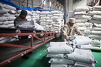 A picture dated April 18, 2013 shows a worker loading quinoa in a quinoa manufacturing plant, Jacha Inti in the city of El Alto in Bolivia.  2013  was declared the international year of Quinoa by the UN.  Bolivia is the main producer of quinoa in the world.