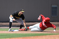 Pittsburgh Pirates infielder Walker Gourley (50) tags out Larry Greene sliding into third during a minor league spring training game against the Philadelphia Phillies on March 18, 2014 at the Carpenter Complex in Clearwater, Florida.  (Mike Janes/Four Seam Images)