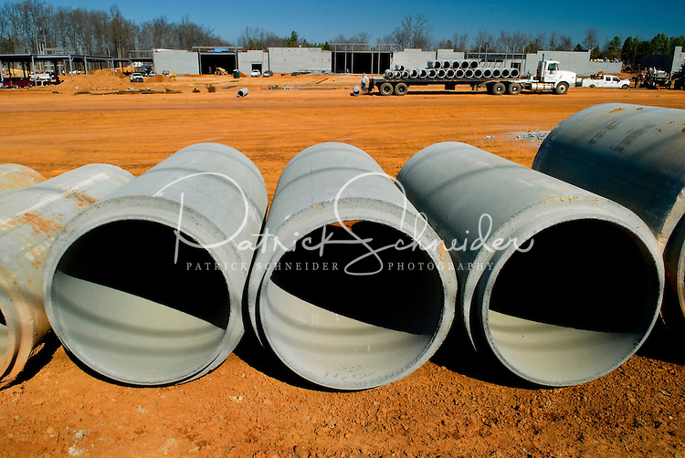 02/22/07:  Cement pipes for infrastructure lay ready to be placed during expansion/construction of a Charlotte-area shopping center. Charlotte, NC, is one of the country's fastest-growing cities. ..By Patrick Schneider- Patrick Schneider Photography.
