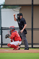 Umpire Chad Westlake calls a strike behind catcher Bruce Wang (5) during a Gulf Coast League game between the GCL Tigers West and GCL Phillies West on July 27, 2019 at the Carpenter Complex in Clearwater, Florida.  (Mike Janes/Four Seam Images)