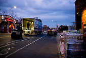 April 21, 2020<br /> Brooklyn, New York<br /> Park Slope<br /> <br /> Trucks bring food deliveries to Whole Foods in Brooklyn at dawn at the height of the coronavirus pandemic.