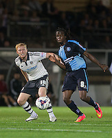 Ben Pringle of Fulham and Marcus Bean of Wycombe Wanderers in action during the Capital One Cup match between Wycombe Wanderers and Fulham at Adams Park, High Wycombe, England on 11 August 2015. Photo by Andy Rowland.