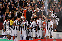 Calcio, finale Tim Cup: Milan vs Juventus. Roma, stadio Olimpico, 21 maggio 2016.<br /> Italian President Sergio Mattarella gives the trophy to Juventus' Giorgio Chiellini at the end of the Italian Cup final football match between AC Milan and Juventus at Rome's Olympic stadium, 21 May 2016. Juventus won 1-0 in the extra time.<br /> UPDATE IMAGES PRESS/Isabella Bonotto