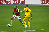 3rd October 2020; Riverside Stadium, Middlesbrough, Cleveland, England; English Football League Championship Football, Middlesbrough versus Barnsley; Britt Assombalonga of Middlesbrough FC  in action watched by Michael Sollbauer of Barnsley FC