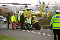 Firefighters, a doctor and paramedics loading a casualty on a stretcher from a road traffic accident to an awaiting air ambulance. ..© SHOUT. THIS PICTURE MUST ONLY BE USED TO ILLUSTRATE THE EMERGENCY SERVICES IN A POSITIVE MANNER. CONTACT JOHN CALLAN. Exact date unknown.john@shoutpictures.com.www.shoutpictures.com..