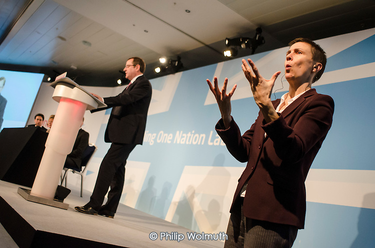 Woman signer.  Labour Party Special Conference on reform of its links to trade unions, ExCel Centre, London.