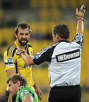 Hurricanes captain Conrad Smith makes his feelings known to Adam Thomson and referee Bryce Lawrence during the Super 15 rugby match between the Hurricanes and Highlanders at Westpac Stadium, Wellington, New Zealand on Saturday, 17 March 2012. Photo: Dave Lintott / lintottphoto.co.nz